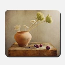 Wild flowers with cherries on table. Mousepad