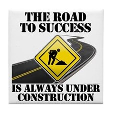 The Road to Success Is Always Under C Tile Coaster