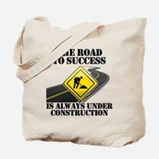 The Road to Success Is Always Under Const Tote Bag