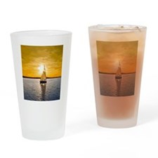 Sailing into the sunset Drinking Glass