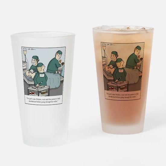 Surgeon going through wallet Drinking Glass