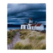 stormy lighthouse Throw Blanket