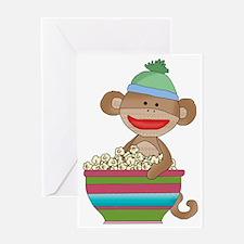Sock monkey with popcorn Greeting Card