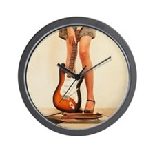 Woman holding guitar and standing on bo Wall Clock