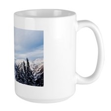 A skier jumping off a cliff in the back Mug