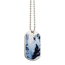 A snowboarder jumping off a cliff in the  Dog Tags