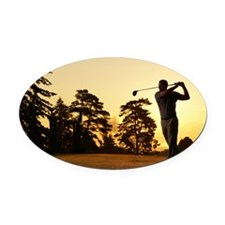 Golfer swinging club on golf cours Oval Car Magnet