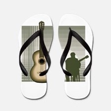 acoustic guitar player sitting brown Flip Flops