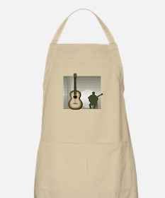 acoustic guitar player sitting brown Apron
