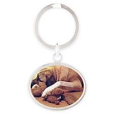 Dog with toy 1 Oval Keychain