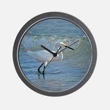 Snowy egret on the beach Wall Clock