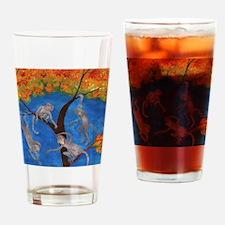 Monkeys hanging around Drinking Glass