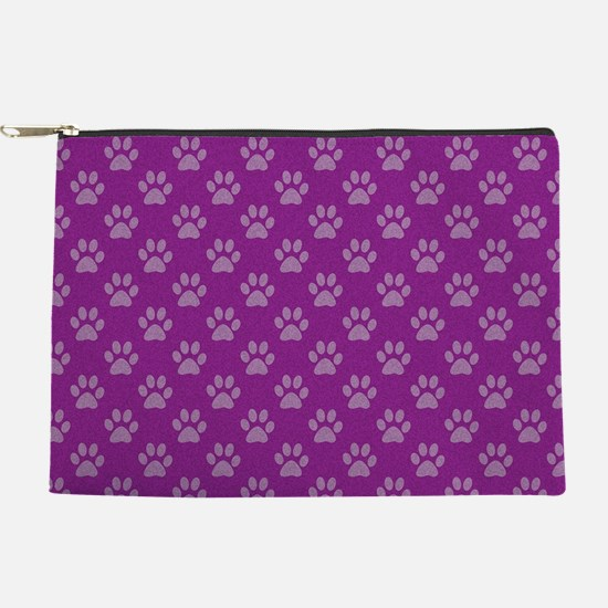 Puppy paw prints on purple background Makeup Pouch