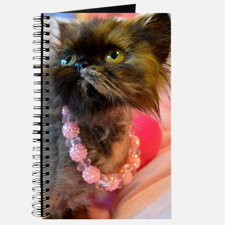 Freida wearing her favorite pink pearls Journal