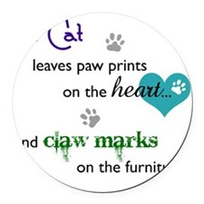 A cat leaves paw prints... Round Car Magnet