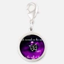 Through the eye of lupus Silver Round Charm