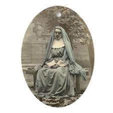 Sad Nun Oval Ornament