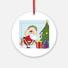 funny santa bit by dog Round Ornament