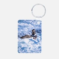 Seagull in flight over whi Keychains
