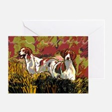 Brittany spaniels in the field Greeting Card