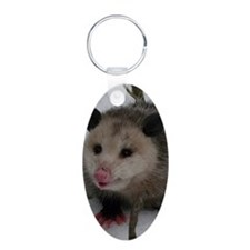 Snow Possum Aluminum Oval Keychain