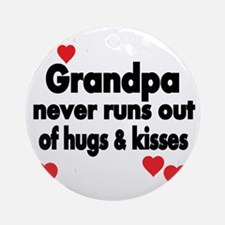GRANDPA NEVER RUNS  OUT OF HUGS  KI Round Ornament