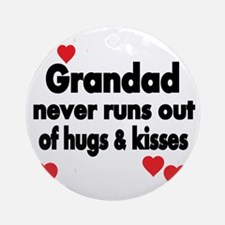 GRANDAD  NEVER RUNS  OUT OF HUGS  K Round Ornament