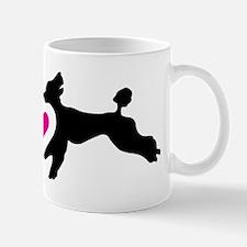 Two black standard poodles running toge Mug