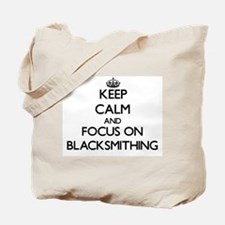 Keep calm and focus on Blacksmithing Tote Bag