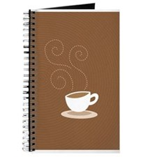 Coffee cup on brown Journal