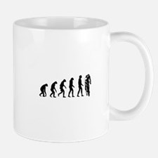 evolution cyclist Mugs