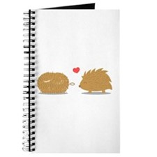 Cute hedgehog falls in love with scrub brush Journ