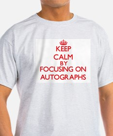 Keep calm by focusing on on Autographs T-Shirt
