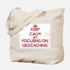 Keep calm by focusing on on Geocaching Tote Bag