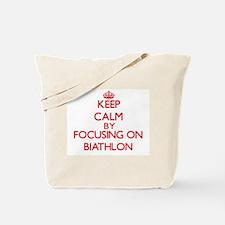 Keep calm by focusing on on Biathlon Tote Bag