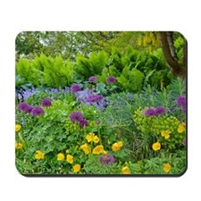 Lush green summer garden Mousepad