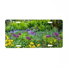 Lush green summer garden Aluminum License Plate
