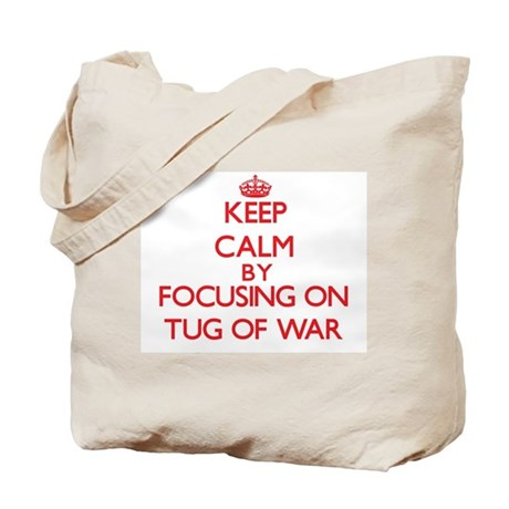 Keep calm by focusing on on Tug Of War Tote Bag
