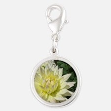 a row of white flowers Silver Round Charm