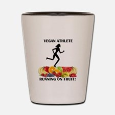 Lady Vegan Athlete Running on Fruit Shot Glass