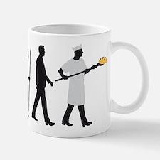Evolution of man baker Mugs