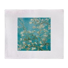Flowers on tree branches by Vincent van Gogh Throw