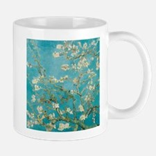 Flowers on tree branches by Vincent van Gogh Mugs