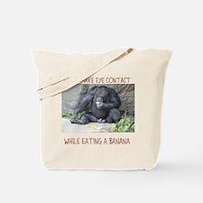 Monkey eating a banana Tote Bag