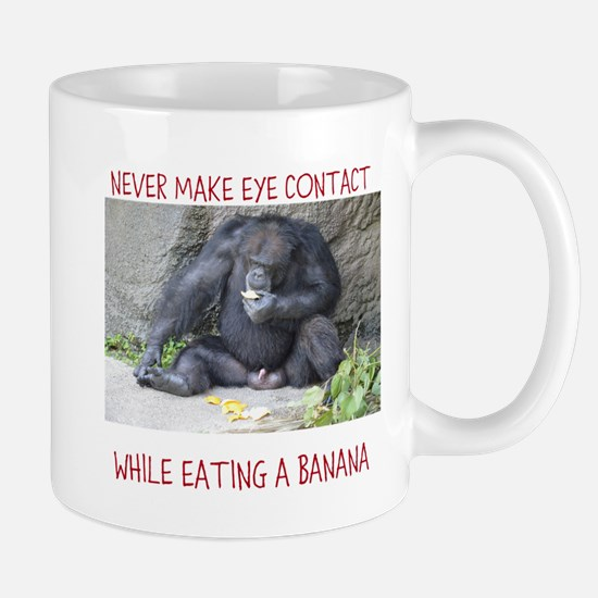Monkey eating a banana Mugs