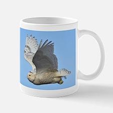Snowy in flight Mug