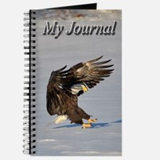 Eagle landing in snow Journal