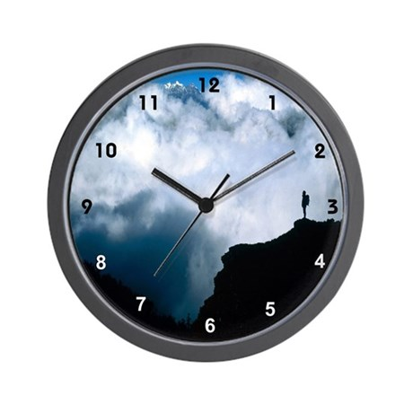 mountain climbing blue skys Wall Clock
