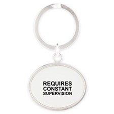 Requires Constant Supervision Oval Keychain