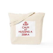 Keep calm by hugging a Zebra Tote Bag